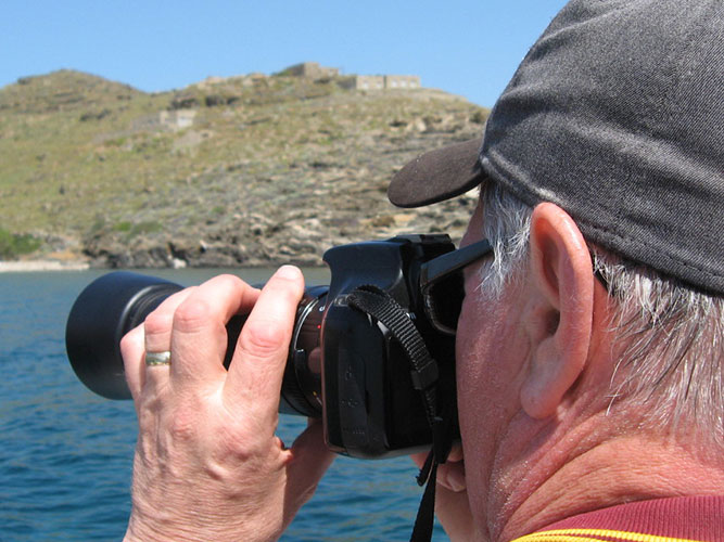Guest busy on his camera photographing bird life