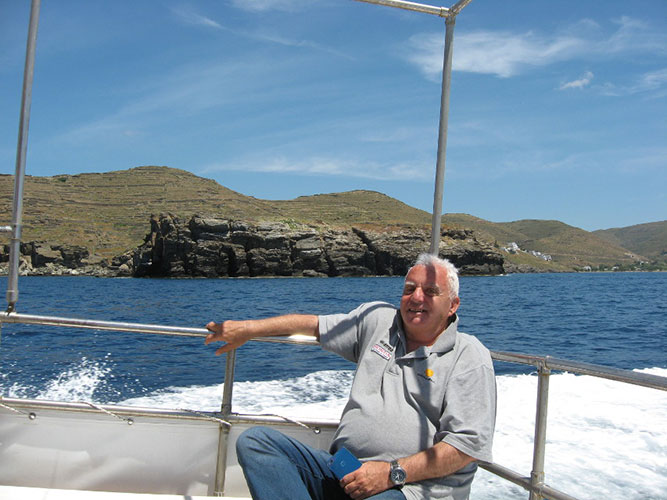 Relaxing on the aft deck, Vryokastro city behind